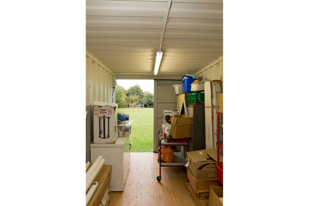 Shipping Container used for extra storage space for school