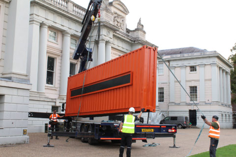 Crane delivery of container to London museum