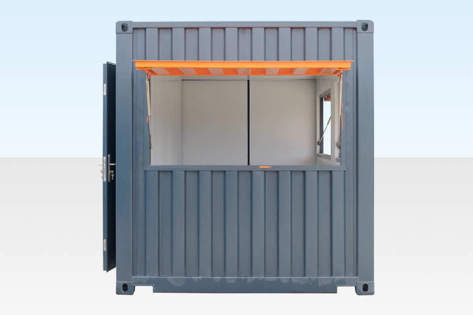 End view of container cafe with serving hatch and door open