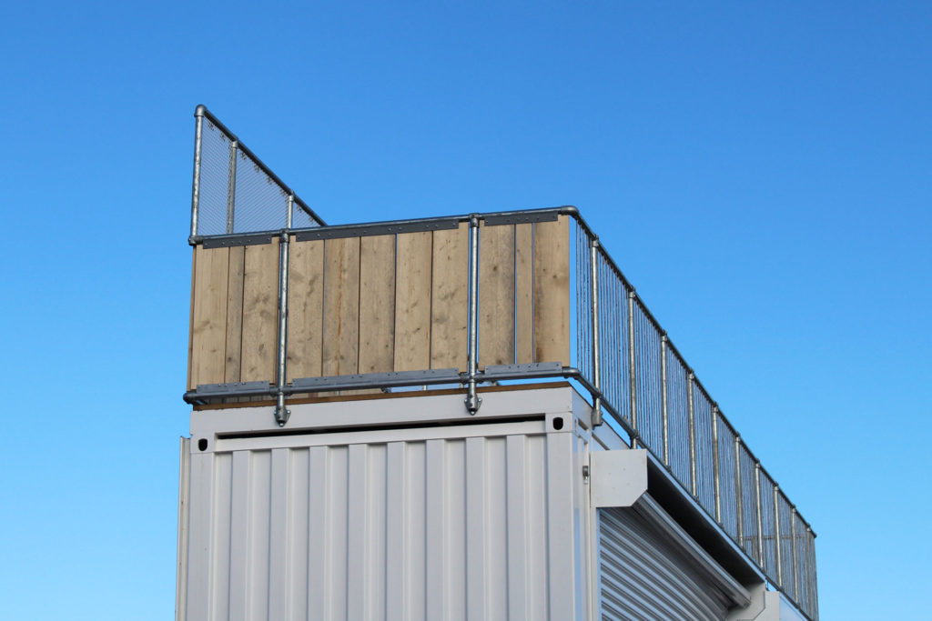secure party area on top of converted container bar